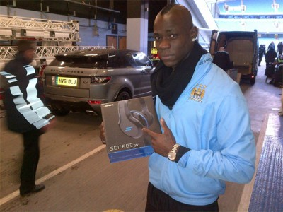 Mario Balotelli of Manchester City with Street by 50 headphones